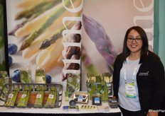 Lulu Vasquez with Gourmet Trading Company proudly shows asparagus and blueberries.