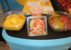 Mango cheeks (with or without skin) and mango salsa for foodservice on display at the booth of the National Mango Board.