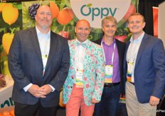In a flowerful outfit, Gabe Romero with Mann Packing joins Brett Libke, Chris Ford and Jim Leach in Oppy's booth.