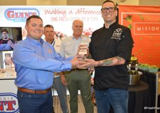 Chef Travis Peters of The Parish in Tucson, AZ (representing Shamrock Foods, a Markon Cooperative member) won Cal Giant's 2nd annual Chef Invitational and receives the award from Tom Smith with California Giant.