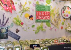 The booth of Fresh Origins. The company produces Microgreens, PetiteGreens, Edible Flowers, Tiny Veggiesas well as Herb, Flower Fruit Crystals.