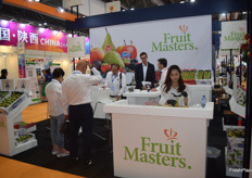 The Fruit Masters stand, preparing for the day.
