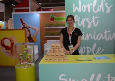 Annabel Hall at the Rockit stand with small cardboard gift packs with one Rockit apple to give to visitors.
