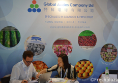 Luis Chadwick Fresard and Jessie Chan from Global Andes Company Limited. Busy working in their booth. Their company is focused on importing and wholesaling of fruit and seafood in Hong Kong and China. They import fruits from Chile, Peru, Mexico, Argentina and India.