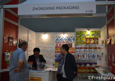 Zhongxing Packaging team together with a client discussing the different packaging options.