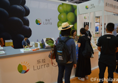 Team of Lurra (Shenzhen) Trading Co., Ltd. busy presenting their products to visitors. They mainly trade grapes, persimmon, strawberry and loquat.