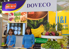 Mrs Dinh Thu Huong (sales & purchase manager) and her colleague are presenting DOVECO.