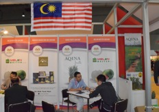 Representatives of Melon Master Sdn.Bhd are receiving visitors at the booth.