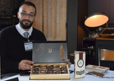 Musab Nazzal, the general manager of Pure Palestine, holding one of the company's premium packaging options: a selection of stuffed dates.