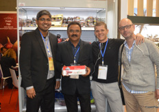 Ajay T G, X, Walo Berger and Marcel Bangerter at the Sam Agri stand, showcasing the packaging of their pomegranate arils.