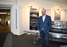 Josh Gray of A&B Packing Equipment, next to the G2Evolution packing machine.