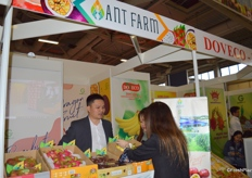 Mr Tony Nguyen of Ant Farm Co., Ltd. is introducing his tropical fruits to visitors.