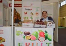 The sales director Mr Khuu Hoang Anh of Prosonan Fruit Co., Ltd with his delicious exotics fruit display.