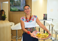 Paulina Carrera wearing traditional Ecuadorian clothing while showing off Ecuador's most important fruits.