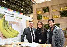 Freddy Rodriguez and Karla Asqui of Fanalba, with one of their customers. The company grows and exports conventional bananas.