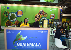 Carina Paz Urrutia, International Event Coordinator, and Miguel Solis, Trade Counselor for the Guatemalan Embassy, at the Guatemalan pavilion.