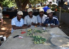 Making the beautiful beaded avocado key rings that delegates received: Willard Charuma, Joseph Kutama, Peter Chivazve and John Kirichi.