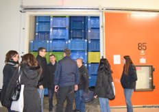 Visitors taking a look into the cold storage unit.