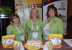 Jessica Brady, Jennifer Armen and Jeanette de-Coninck- Hertzler with Okanagan Specialty Fruits. On display are sliced are sliced Arctic apples as well as the new packaging for them.