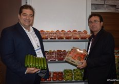 Dino Dilaudo and Tony Cappelli with Westmoreland- TopLine Farms. Dino shows a new club pack of mini cucumbers. Tony shows a pack of 4 lbs. organic Tomatoes on the Vine, a new product as well.