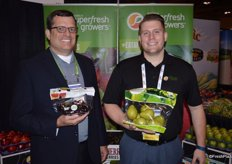 Mike Preacher and Ryan Cleary with Superfresh Growers. Mike shows a pouch bag with organic dark sweet cherries and Ryan holds a 3 lbs. pouch bag of D'Anjou pears.