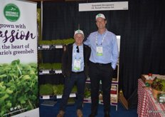 Ian Adamson and Michael Curry with Greenbelt Microgreens proudly stand in front of the microgreens display.