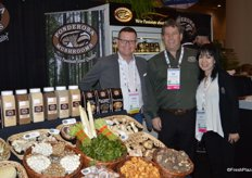 Brian Pederson of Kuehne + Nagel Ltc. is visiting the Stupendous Ponderosa Mushroom booth of Joe Salvo and Lyn Luu