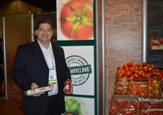 Dino Dilaudo of Westmoreland Sales showing a wide variety of tomatoes.