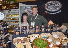 Lyn Luu and Joe Salvo with Ponderosa Mushrooms. Beautiful white asparagus on display in the booth.