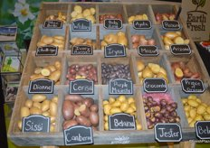 Display with a small selection of Earth Fresh' Potatoes.