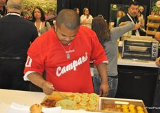 Chef/Musician Roger Mooking is preparing one of his recipes with Sunset greenhouse products.