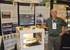 Denny Bilton from MAF Industries promotes the IDD2, which can detect internal damage in apples.