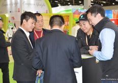 Interest from Chen's Sun for Australian produce at the stand of Fruit Growers Australia.