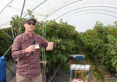Parker Weiss explains to the group why Driscoll's is moving into container farming for berries.