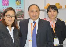 David Wang, the president of Jinan Haoyuan Agricultural Products from Jinan in Shandong provice, together with Clara Wang to his right and Zhao Junmei to his left. The company grows pear, apple and citrus.