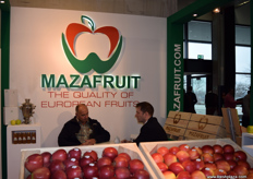 Michal Stokowski (right) from Maza Fruit, speaking with a customer at the company's stand.