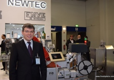 Frank Biesel- Engineer showing the Biesel packing machine at their stand.