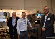 Gunner Hansen, Morten Berenth Nielsen and Mads Nychel from Egatec, showing their machine which sorts packaged goods into crates.