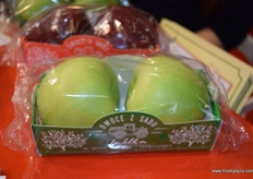 A close up of the small apple packaging offer by Fruit Logistics.