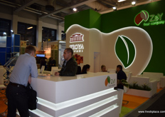 A view of a busy stand for Z&Y fruit company from St. Petersburg, Russia.