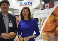 Joel Starling and Annette Starling showing sweet potatoes from North Carolina.