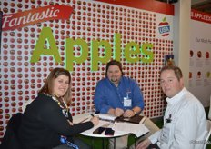 Marta Molla Insa visiting the booth of United Apples Sales with next to her Josh Tunstall and Brett Baker with United Apple Sales.