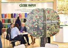 Lorenzo and Fabrizio Govi with a client at the Ciesse Paper stand.