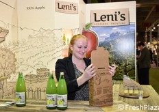 Barbara while she places two bottles of Leni's juice in a practical branded box.
