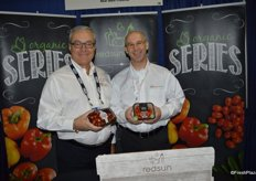 Jim DiMenna and Jim D'Amato with Red Sun Farms showing grape tomatoes on the vine from the Artisan series as well as organic grape tomatoes in a new recyclable package.