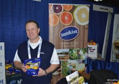 Brad Blaine with Sunkist showing a pouch bag of Meyer Lemons.