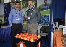Aaron Deherrera and Ron Conrad with Rainier Fruit. In front, Lady Alice apples that will be shipped as of January.