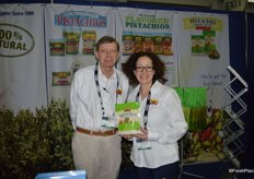 Sheldon Cole and Elise Silvester with Setton Farms showing a new product: pistachio chewy bites.