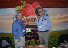 John Heffernan and Kasey Kelley with Naturipe Farms showing the award winning snack packs of blueberries.