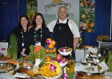 Lots of specialty fruits available on display at the Culinary Specialty booth. From left to right: Lisa Palmisano-Rilho, Matty Meehan and Richard Leibowitz.